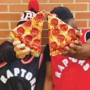 Pizza Pizza Score a Slice: Get a FREE Pepperoni or Cheese Slice When the Toronto Raptors Win at Home and Score 100+ Points