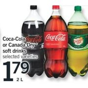 Coca-Cola or Canada Dry Soft Drinks - $1.79